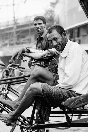 Smile of resting rickshaw wallah