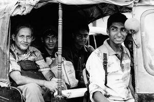 Passengers on auto rickshaw