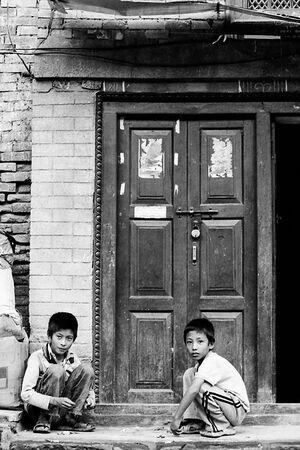 Two boys in front of door