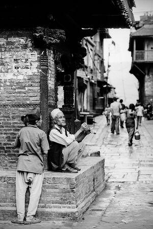 Men in corner of street
