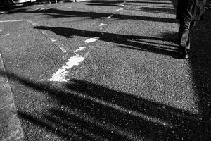 Shadows of a pedestrian on ground