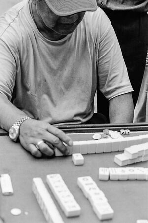 Man playing mahjong