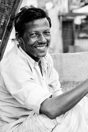 Rickshaw wallah grinning