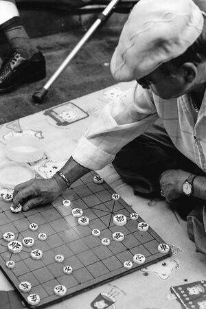 older man playing Korean chess