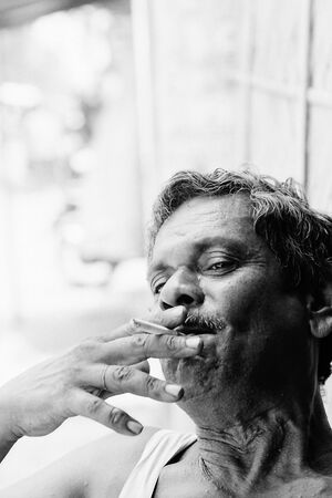 Man smoking in a relaxed way