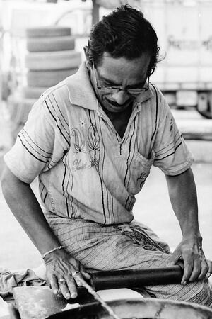 Man making Roti