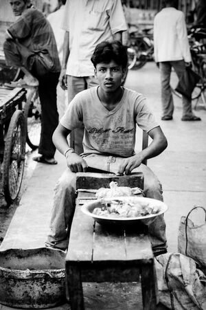 Man precooking by the roadside