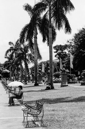Women sitting on bench in Rizal Park