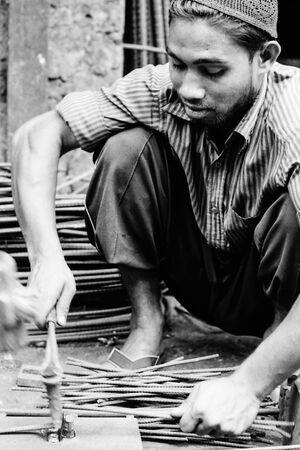 Man fastening nailhead
