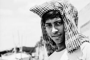 Young man with cloth on head