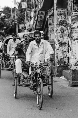 Man pointing on cycle rickshaw