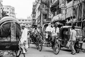 Cycle rickshaw with passenger running