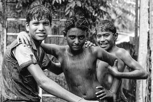 Boys standing in the rain