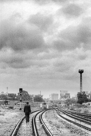 Man walking railway track