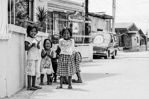 Kids smiling by wayside