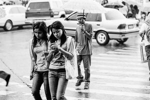 Girl watching cell phone