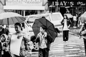 Boy putting umbrella up