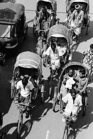 Cycle rickshaws in wide street