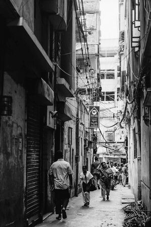 Dim alleyway between buildings in Dhaka