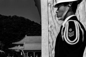 Guardsman closing eyes in Martyrs' Shrine
