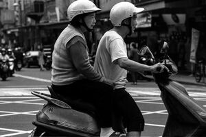 Old couple on same motorbike
