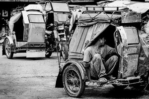 Man chatting in side car