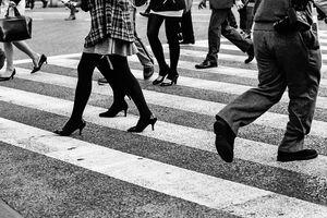 Legs crossing street
