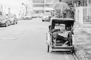 Pedicab driver taking a nap