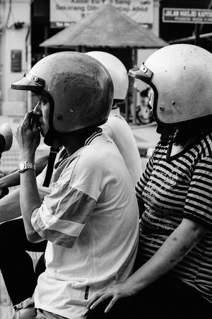 Two helmets on motorbike