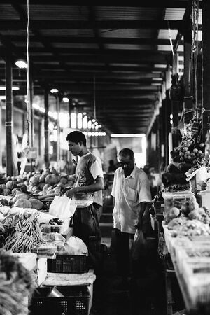 Young man buying in market