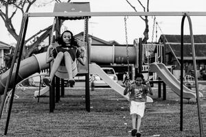Two girls on swing