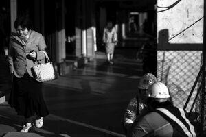 Woman walking sidewalk