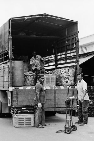 Men delivering goods in market