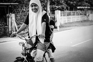 Girl pedaling bicycle