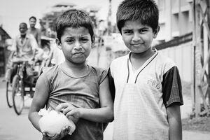 Two boys and plastic bag