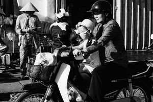 Mother and her daughter on motorbike
