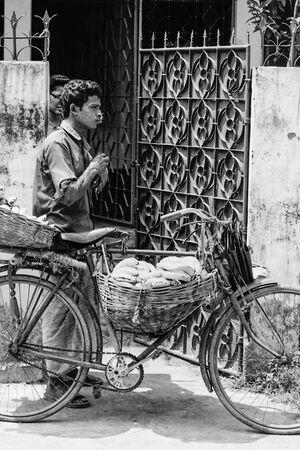 Man peddling bananas