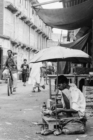 shoemaker under unbrella