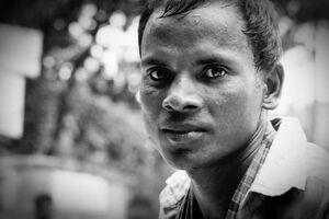 Sweltering rickshaw man