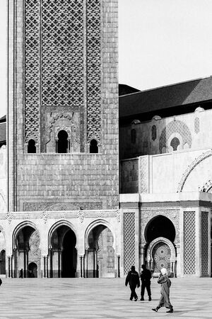 Figure walking square in front of Grande Mosquée Hassan II
