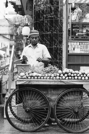Street vendor selling mangoes