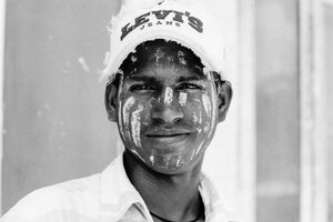 Young man painted Thanaka on face