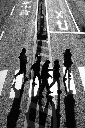 Silhouette crossing street