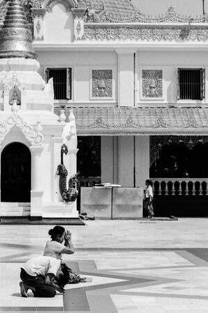 Worshipers praying in Shwedagon Paya