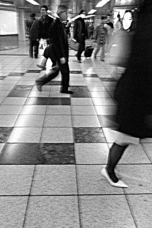 Pedestrians walking in brisk pace