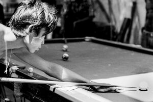 Young man holding cue stick