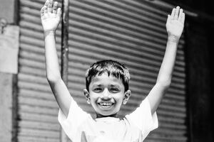 Boy raising arms up