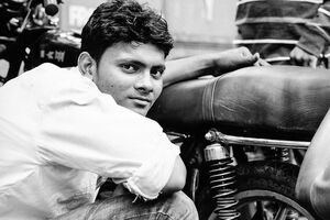 Young man beside motorbike