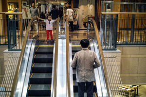 Boy watching escalator