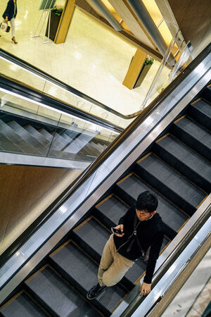 Young man on escalator